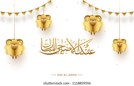 Arabic calligraphy text Eid-Al-Adha, Islamic festival of sacrifice concept with hanging golden paper sheeps and bunting flags on white background.
