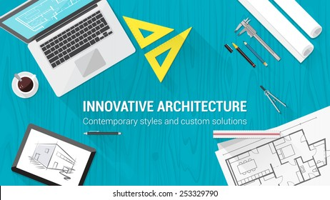 Architect desktop with tools including laptop, tablet and building plan