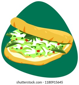 Arepa with shredded white chicken meat tossed with avocado, mayonnaise, garlic, onion, bell pepper, jalapeno and cilantro on green background