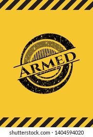Armed black grunge emblem inside yellow warning sign. Vector Illustration. Detailed.