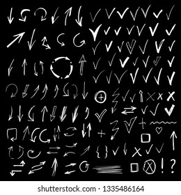 Arrows, check marks, signs. Hand drawn, doodle, sketch design elements set isolated on black background