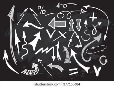 Arrows vector set on chalkboard. Hand drawn elements.