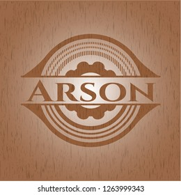 Arson badge with wooden background