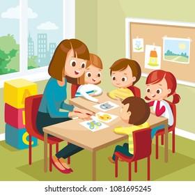 Art classroom interior with pupils. Teacher with pupils. Preparing for school.