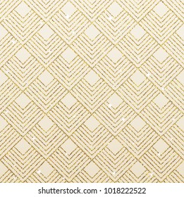 Art deco seamless pattern with gold rhombus tiles scales and golden sparkle texture.
