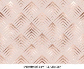 Art deco seamless pattern with rose gold rhombuses tiles.