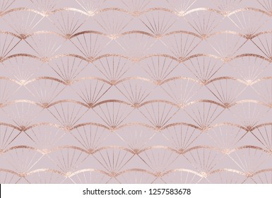 Art deco seamless pattern with rose gold fan tiles.