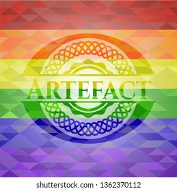 Artefact emblem on mosaic background with the colors of the LGBT flag