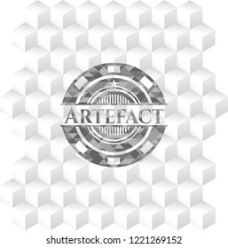 Artefact grey badge with geometric cube white background