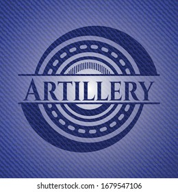 Artillery badge with denim background. Vector Illustration. Detailed.