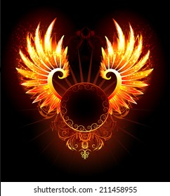 Artistically painted,  round banner with fiery phoenix wings on black background.