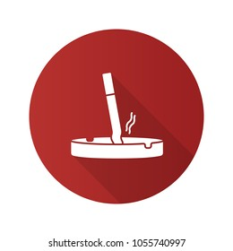 Ashtray with stubbed out cigarette flat design long shadow glyph icon. Stop smoking. Vector silhouette illustration