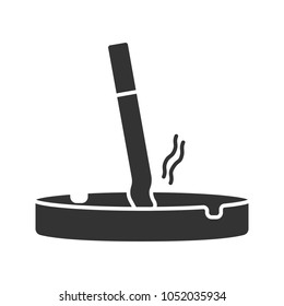 Ashtray with stubbed out cigarette glyph icon. Stop smoking. Silhouette symbol. Negative space. Vector isolated illustration