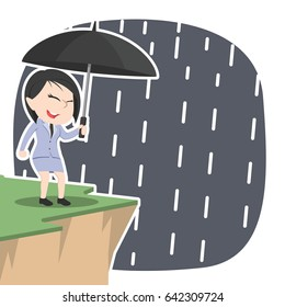 asian businesswoman with umbrella standing near cliff edge