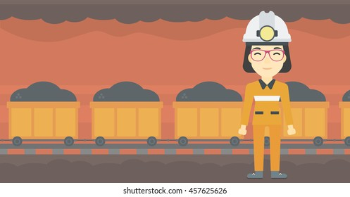 An asian confident coal miner. Female miner in hardhat with torch. Miner standing on the background of mining tunnel with cart full of coal. Vector flat design illustration. Horizontal layout.