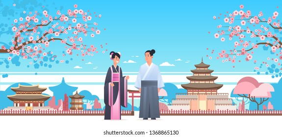 asian couple wearing traditional clothes man woman in ancient costume standing together chinese or japanese characters over pagoda buildings landscape background full length horizontal
