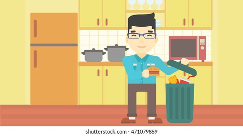 An asian man putting junk food into trash bin. Man refusing to eat junk food. Man throwing junk food on the background of kitchen. Diet concept. Vector flat design illustration. Horizontal layout.