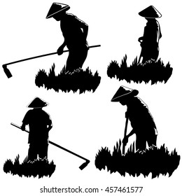 Asian peasants work on a field