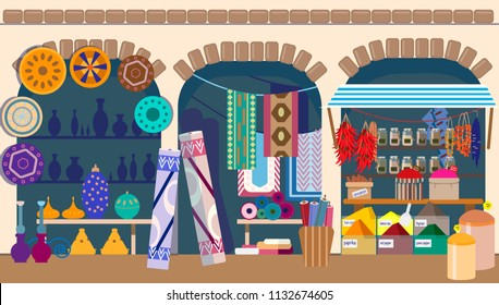 Asian street market with pottery, carpets and spices stores.