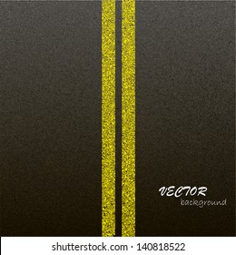 Asphalt dark texture with yellow lines.