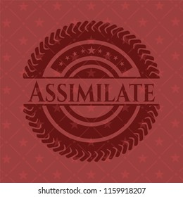 Assimilate red emblem