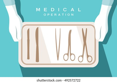 Assistant of the surgeon holds surgical instruments on the medical tray