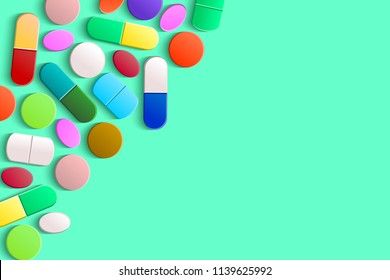 Assorted pills, tablets and capsules in the upper left corner on a light green background, top view. Pharmaceutical medicine concept with copy space.