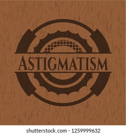 Astigmatism badge with wood background