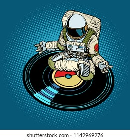 Astronaut man meditates to music, yoga. Pop art retro vector illustration kitsch vintage