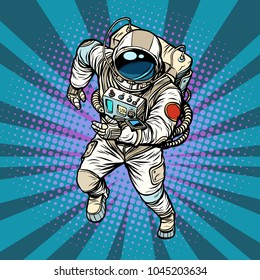 astronaut runs, the hero of space. Pop art retro vector illustration comic cartoon vintage kitsch drawing