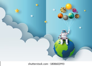 The astronaut is sitting on earth holding planet balloons, pop up, greeting and birthday cards, education concept, paper cut style, flat-style vector illustration.