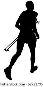 athlete skyrunner with trekking pole in hand running mountain marathon