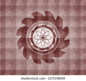 atom icon inside red seamless emblem with geometric pattern.