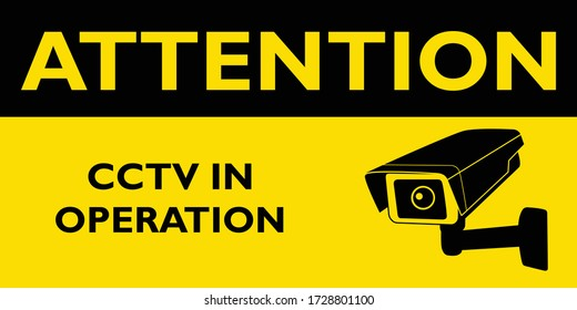 Attention cctv in operation yellow sign