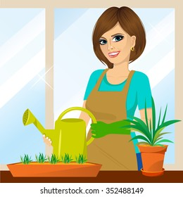 attractive lovely housewife on the balcony holding watering can