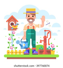 Attractive young gardener with a watering can in overalls stands in a garden on a background of flowers and shrubs near the old water pump.  Modern vector character in flat design.