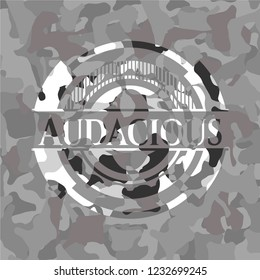 Audacious on grey camouflage texture