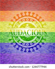 Audacious on mosaic background with the colors of the LGBT flag
