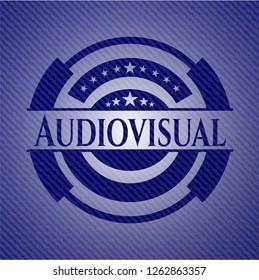 Audiovisual badge with denim texture