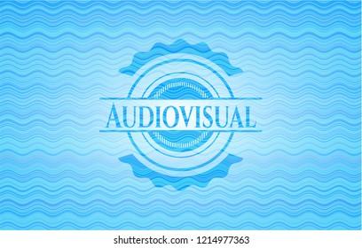 Audiovisual light blue water badge.