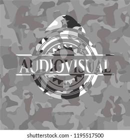 Audiovisual on grey camouflage pattern