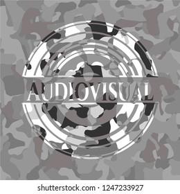 Audiovisual on grey camouflage texture