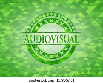 Audiovisual realistic green emblem. Mosaic background