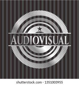 Audiovisual silvery emblem or badge