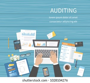 Auditing concepts. Businessman auditor inspects assessing financial documents. Man's hands with laptop, documents, forms, graphics, charts. Research,management, analysis, data, planning, accounting.