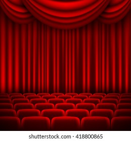 an auditorium with a seating area and a red curtain