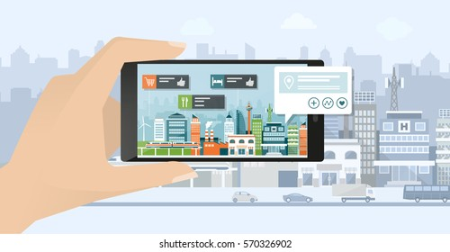 Augmented reality, navigation and location concept: hand holding a smartphone and viewing a city street, the user is searching places using an app