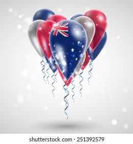 Australian flag on air balls in heart-shaped. Celebration and gifts. Ribbon in the colors are twisted under the balloon. Independence Day. Balloons on the feast of the national