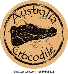 Australian freshwater crocodile silhouette icon round shabby emblem design old retro style. Crocodile head logo mail stamp on craft paper vintage grunge sign. Dangerous Australian predator