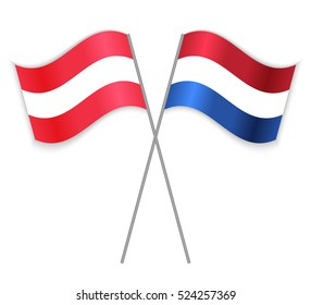 Austrian and Dutch crossed flags. Austria combined with Netherlands isolated on white. Language learning, international business or travel concept.